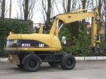 Колесный экскаватор Caterpillar M 318 C  Год выпуска:2004
